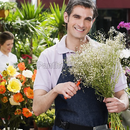 florist making a bouquet of flowers