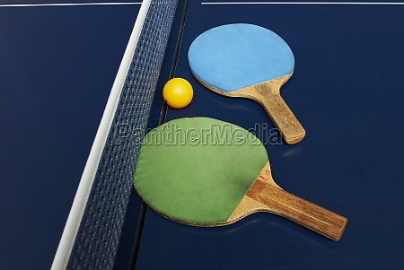 two table tennis rackets with a