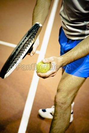 tennis player playing tennis in a