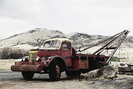 rusty tow truck in a field