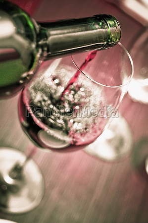closeup of red wine being poured