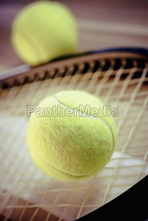 closeup of tennis balls and a