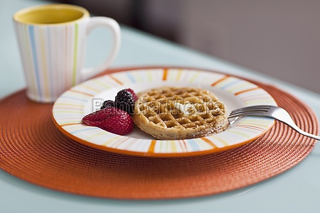 closeup of strawberries with waffles and