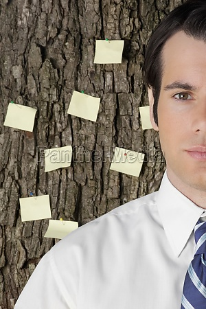 businessman with adhesive notes stuck on