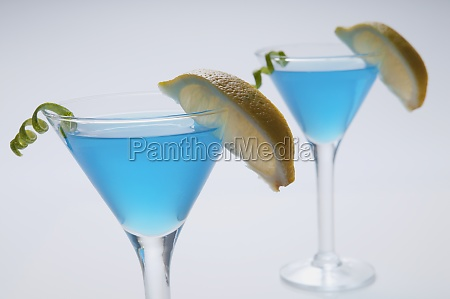 closeup of two glasses of blue