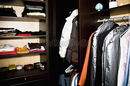 clothes in almirah and shelves