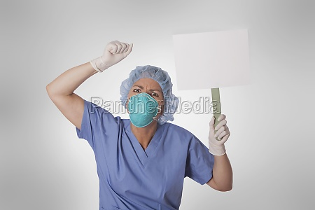 female doctor holding a blank placard