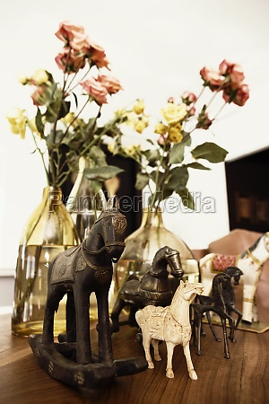 closeup of figurines with flower vases