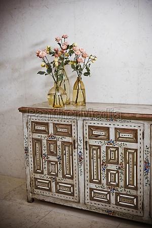 flower vases on a sideboard