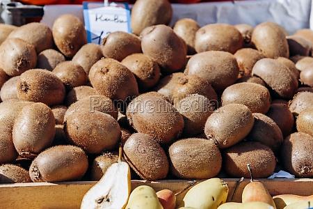 fresh kiwi on the market lots