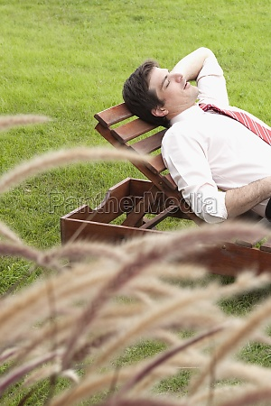 businessman lying on a lounge chair