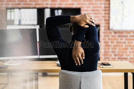 african employee man doing wellness fitness
