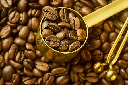 coffee beans in measuring spoon and