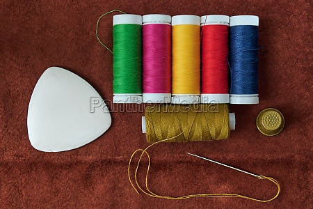 reels with threads needle chalk and