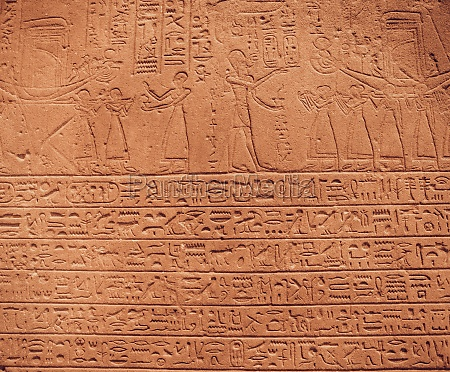 old egypt hieroglyphs carved on the