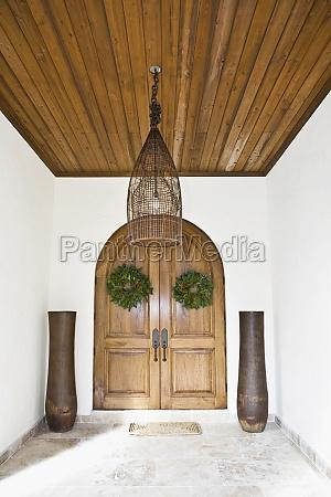 wreaths hanging on the door of