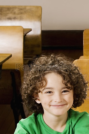 portrait of a schoolboy smiling in