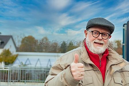 outdoor portrait from a optimistic senior