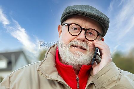 senior using cellphone on his way