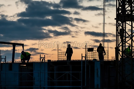 shadows of construction workers