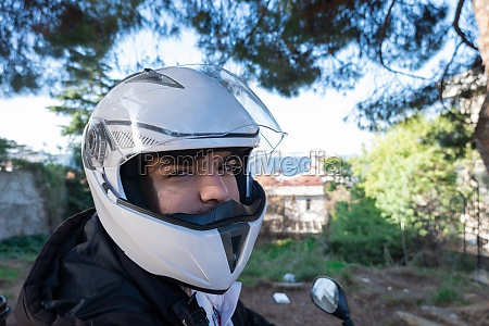 close up of motorcycle courier with