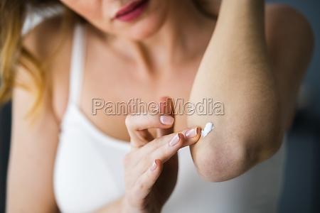 applying cream on healthy dry skin