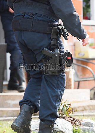 police officer with service weapon