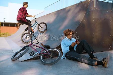 bmx riders lifestyle training in skatepark