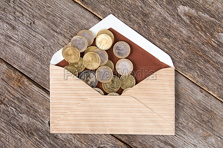 coins scatter from open envelope