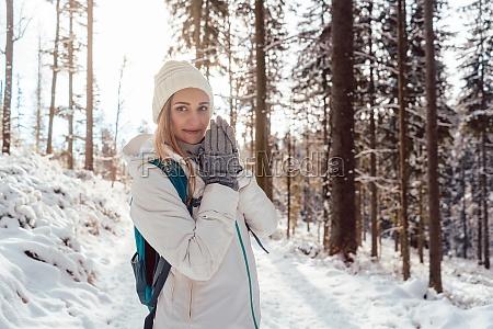 woman on winter hike enjoying the