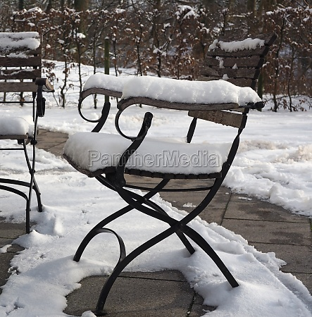 garden chair covered with snow
