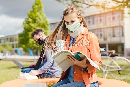 woman student on college campus learning