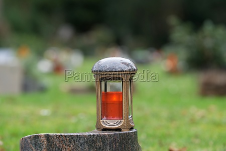 metal grave lantern on a marble