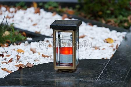 modern metal grave lantern with burning