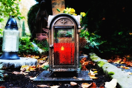 old grave lantern with burning candle