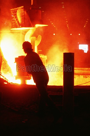 silhouettes of steel worker in a