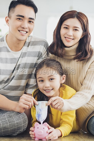 father mother and daughter holding