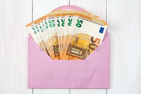 pink envelope with euro bills