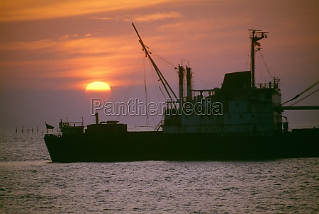 freighter at sunset in ho chi