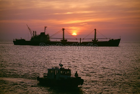 freighter at sunset in the south