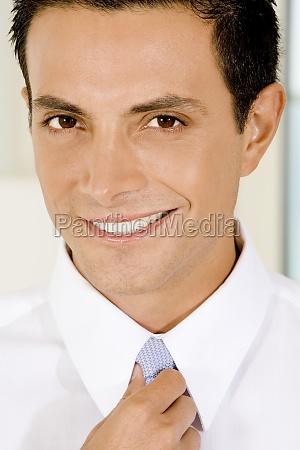 portrait of a businessman adjusting his