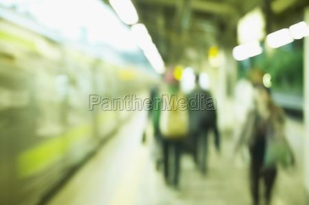 people walking at a subway station