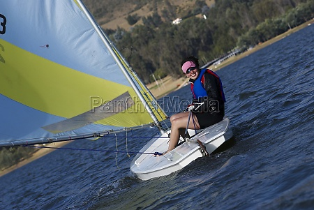 young woman sitting in a sailboat