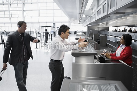 businessman shouting at an airline checkin