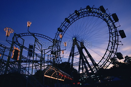 silhouette of amusement park rides prater