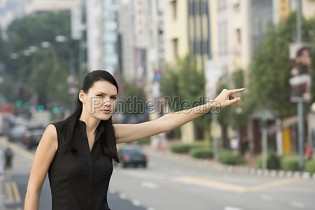 businesswoman hailing for a vehicle
