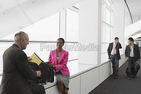 four business executives at an airport
