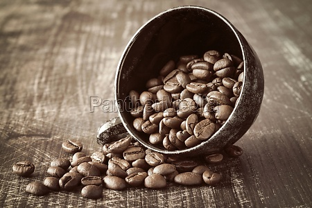 black coffee cup and coffee beans