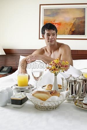 mid adult man sitting on the