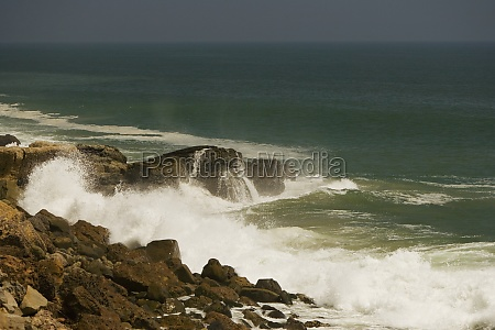 waves crashing against a rock formation